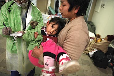 An injured girl is brought to a Japanese Red Cross hospital.