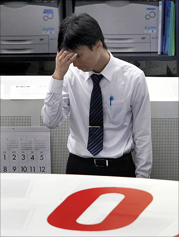 An employee of the Tokyo Stock Exchange (TSE) works at the bourse in Tokyo.