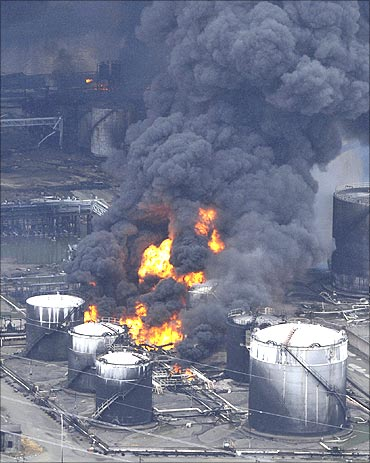 A factory facility burns following an earthquake and tsunami in Sendai.
