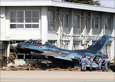 A Mitsubishi F-2 fighter aircraft of the Japanese Air Self-Defense Force swept into a building.