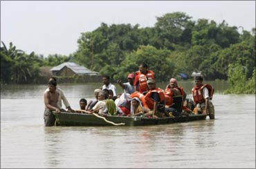 Villagers negotiating a flooded river in Bihar.