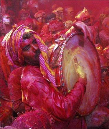 A man plays a drum as he celebrates Lathmar Holi at Barsana in Uttar Pradesh on March 14, 2011.