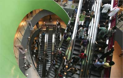 Shoppers ride the escalators at VivoCity shopping mall in Singapore.