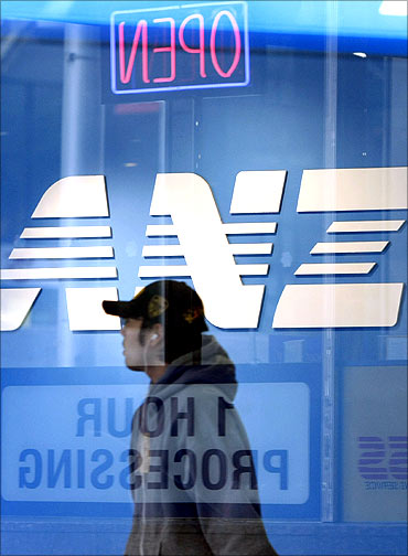 A pedestrian walks past an ANZ bank branch in Melbourne.