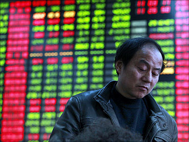 A man monitors stock prices at a securities trading firm.