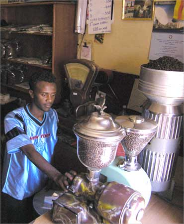 A coffee seller prepares his coffee grinders for business in downtown Asmara, Eritrea.