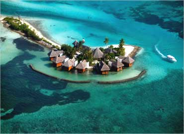 An aerial view shows a resort island at the Male Atoll, Maldives.