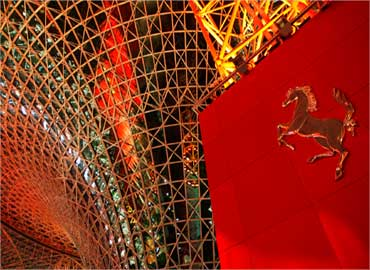 A Ferrari logo is seen under the main central section of Ferrari World Abu Dhabi.