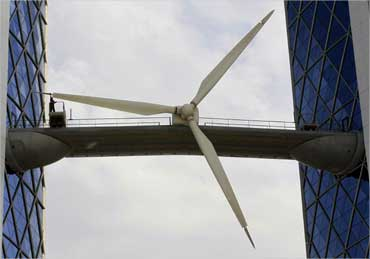 A worker cleans a wind turbine at the Bahrain World Trade Center Building in Manama.