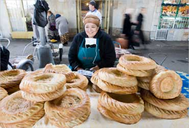 A woman sells traditional Uzbek bread at a market in Tashkent.