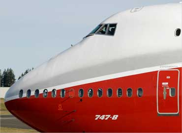 The Boeing 747-8 Intercontinental taxis down the runway before its maiden flight from Paine Field, in Everett, Washington on March 20, 2011.