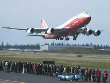 The 747-8 Intercontinental takes off from Paine Filed in Everett, Washington.