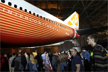 Thousands of Boeing employees and guests take a closer look at the fuselage of the brand new 747-8 jumbo passenger jet.