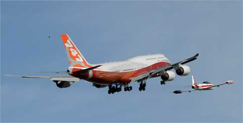 The Boeing 747-8 Intercontinental is followed by a chase plane.