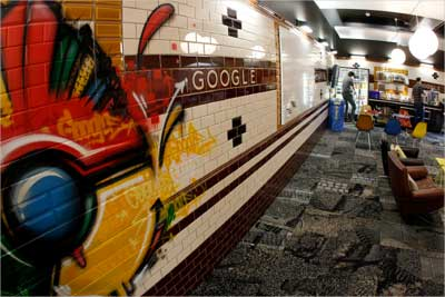 Employees stand in a break room designed as a subway station at the Google building in Zurich.