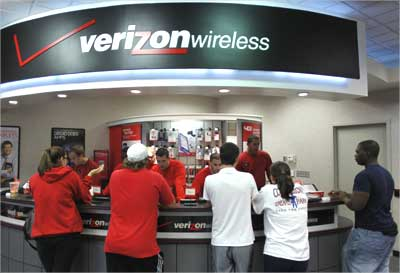 Customers purchase the iPhone 4 with the Verizon Wireless network in Boca Raton, Florida.
