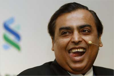 Mukesh Ambani reacts during the 2011 spring membership meeting organised by the IIF in New Delhi.