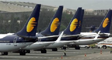 Jet Airways aircraft on tarmac at the domestic airport terminal in Mumbai.