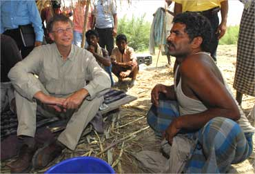 Bill Gates interacts with a villager in Aulali village, Bihar.