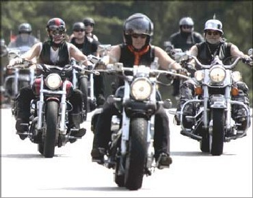 Bikers ride their Harley-Davidsons