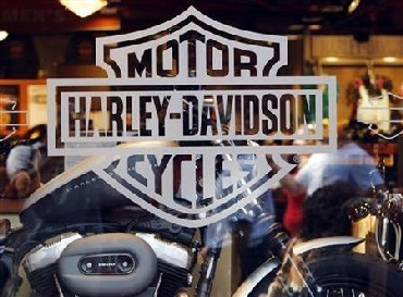 Motorcycle maker Harley Davidson's logo appears on the window of a store