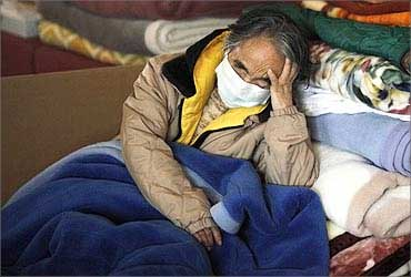 A refugee sleeps at a relief center in Minamisanriku town, Miyagi prefecture.