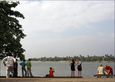Tourists visit Fort Kochi beach in Kochi.