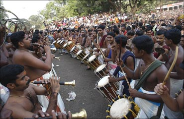 Musicians perform during the procession at the Pooram festival held at the Vadakkumnatha temple.
