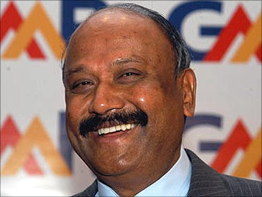 GM Rao has pledged entire stake to a foundation.