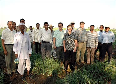 Hemchandra Patil in his field with foreign visitors.