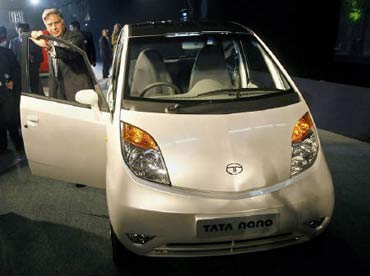 Tata Group chairman Rata Tata with the iconic Nano.