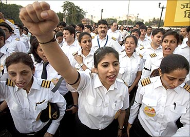 AI pilots take part in a protest march in Mumbai.