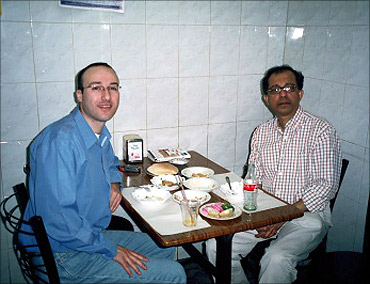 Eating humus at Lina's, in Old Jerusalem, with Hosni Zoabi, 2005.