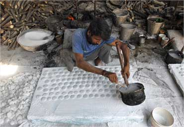 A labourer works inside a sugar-candies manufacturing industry in Ahmedabad.