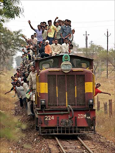 Villagers travel by train on the outskirts of Raipur.