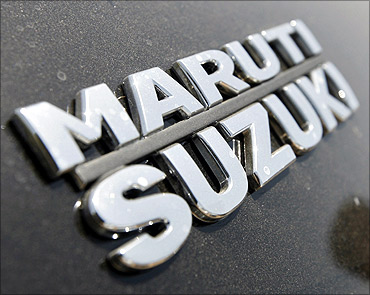 The brand name of Maruti Suzuki pictured on a Swift car.