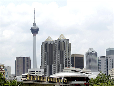 A light rail transit train is seen in downtown Kuala Lumpur.