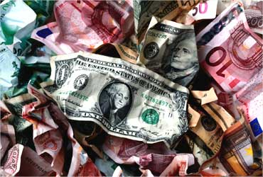 A picture illustration of crumpled kuna, dollar and euro banknotes.