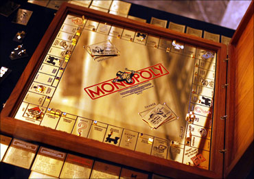 An 18-karat solid gold Monopoly set covered with hundreds of precious gemstones.