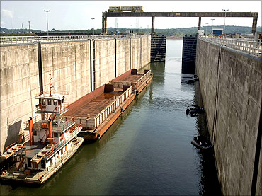 A cargo barge enters a lock of the Tucurui dam on the Tocantins River.