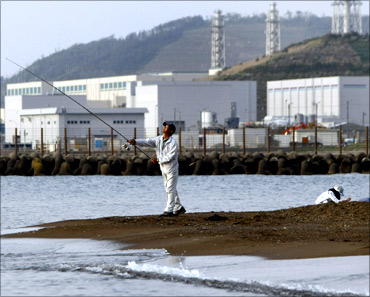 A man fishes near Tokyo Electric Power Co.'s (TEPCO) Kashiwazaki-Kariwa nuclear plant.
