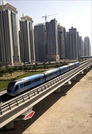 A Dubai Metro train runs past Sheikh Zayed road in Dubai