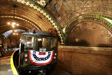 A vintage Low V subway car stands in the original City Hall subway station.