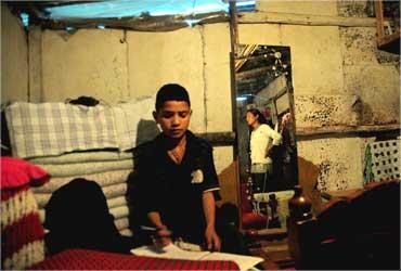 Radha Thakuri's ramshackle tin house.