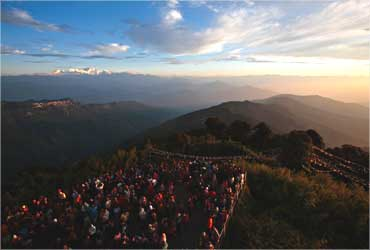 Visitors watch the sun rise from Tiger Hill near Darjeeling.