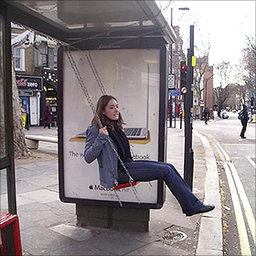 A bus stop with a swing.