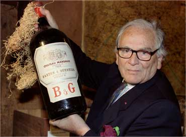 French designer Pierre Cardin presents a four-liter bottle of Chateau Margaux.