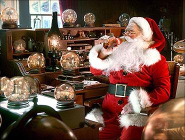 Santa Claus enjoys a Coca-Cola in this publicity image.