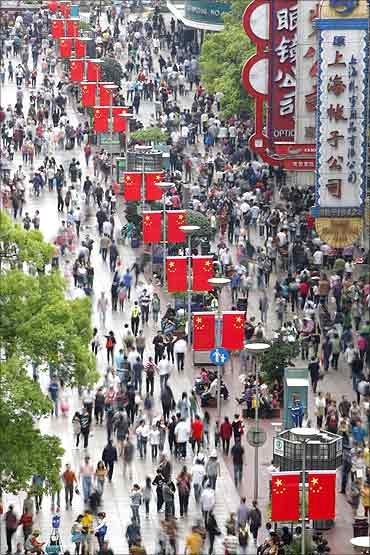 People throng the Nanjing Road shopping district in Shanghai.