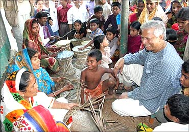 Muhammad Yunus with villagers.